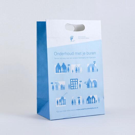 Luxe papieren tas met een volledig uitgestanste handgreep