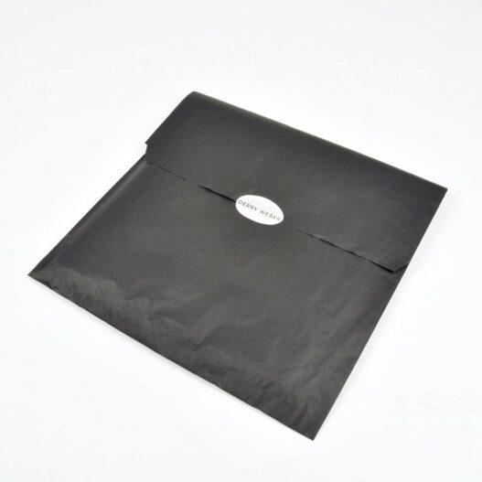 zak van zwart vloeipapier